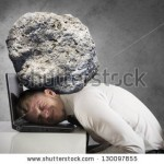 stock-photo-concept-of-stress-with-businessman-with-a-rock-on-the-head-130097855