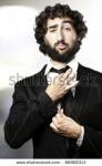 stock-photo-portrait-of-business-man-adjusting-the-tie-indoor-88908313